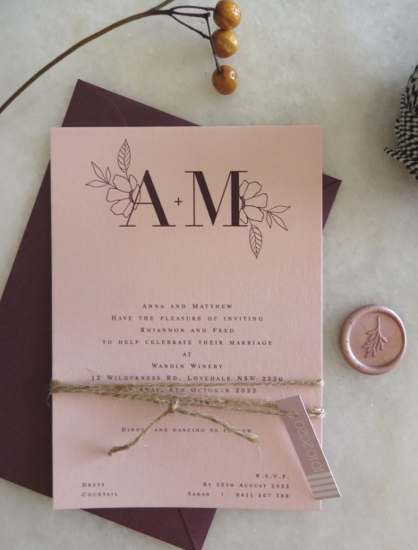 romance on blush wedding invitation