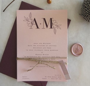 romance on blush wedding invitation