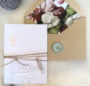 metallic gold and rose gold foil numero uno invitation