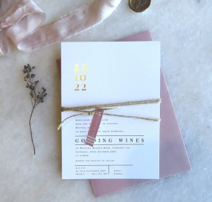 metallic gold and rose gold foil numero uno invitation